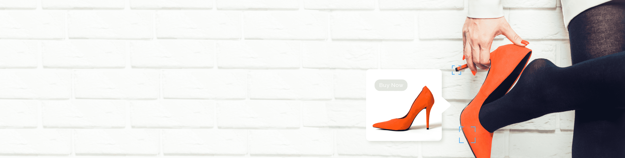 Close up of a hand grasping the heel of a red high heeled shoe and an inset image of the same red shoe in a display ad